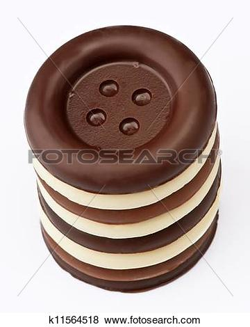 Pictures of group stacked chocolate buttons, on white base.