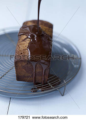 Stock Photography of Coating the marble cake with the chocolate.