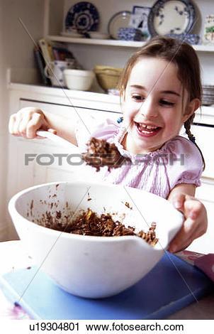 Stock Photography of Girl making Chocolate cornflake cakes.