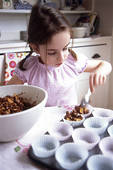 Stock Photography of Girl making Chocolate cornflake cakes.