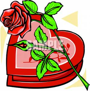 A_red_rose_laying_on_a_heart_shaped_box_chocolates_110104.