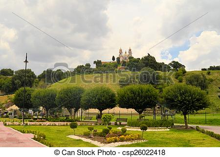 Stock Photography of Great pyramid above Cholula with church.