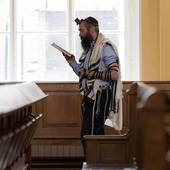 Stock Images of Man reading the Bible in the Grand Choral.