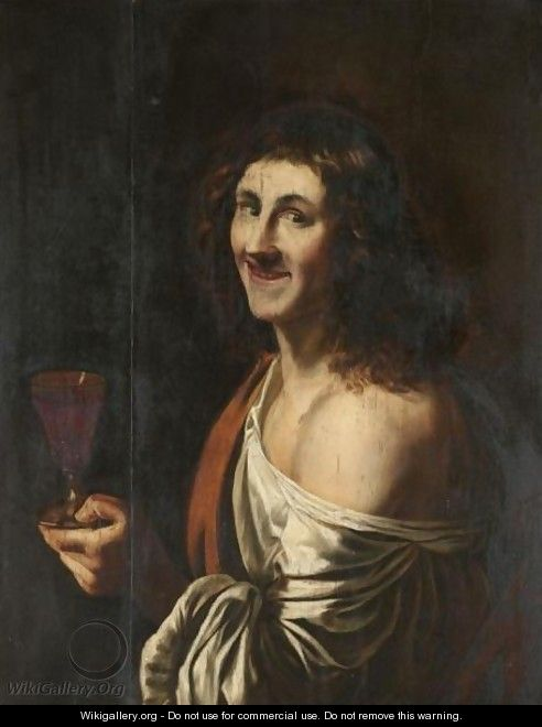 A Man Holding A Glass Of Wine.