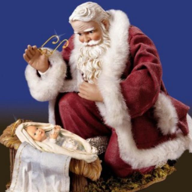 Santa worshipping Baby Jesus..
