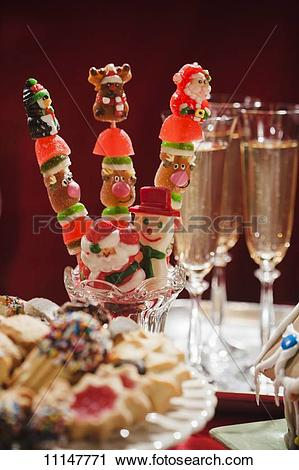 Stock Photography of Festive Christmas Pops on a Dessert Table.