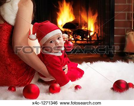 Stock Images of Mother and a little baby boy sitting in front of a.