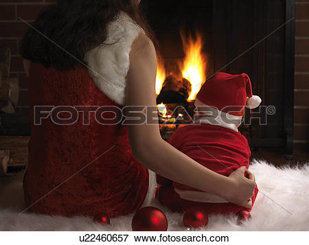 Picture of Mother and a little baby boy wearing Santa costumes.