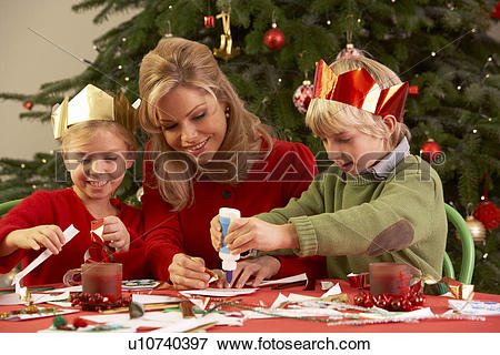 Picture of Mother And Children Making Christmas Cards Together.