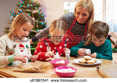 Stock Photography of Mother And Children Decorating Christmas.