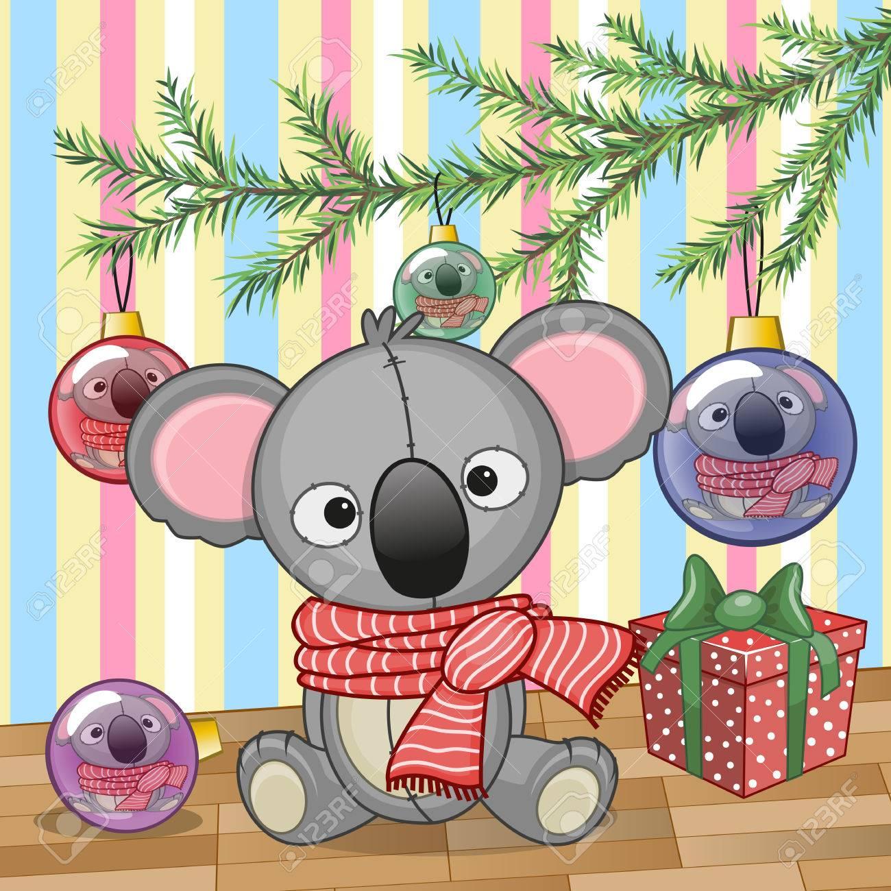 Cute Koala under the Christmas tree.