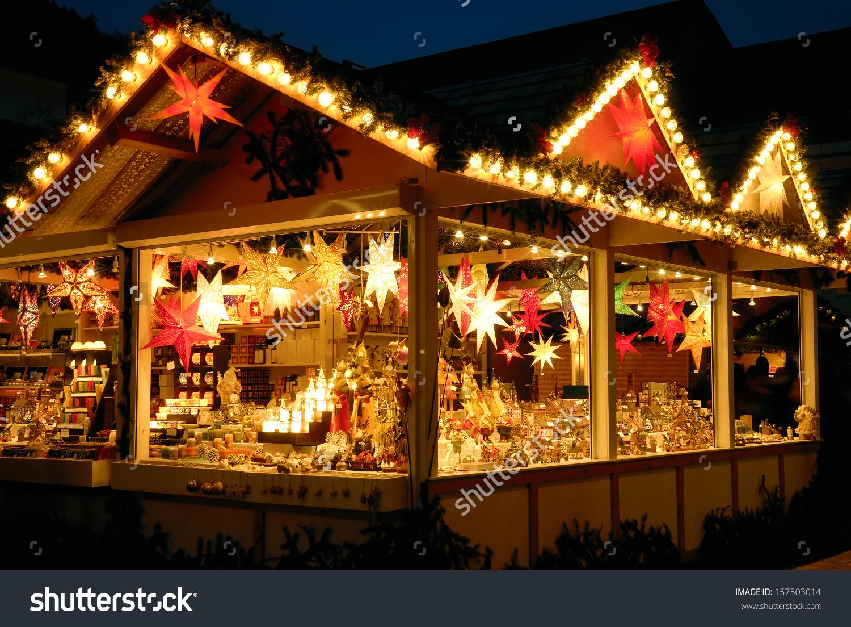 Illuminated Christmas Fair Kiosk Loads Shining Stock Photo.