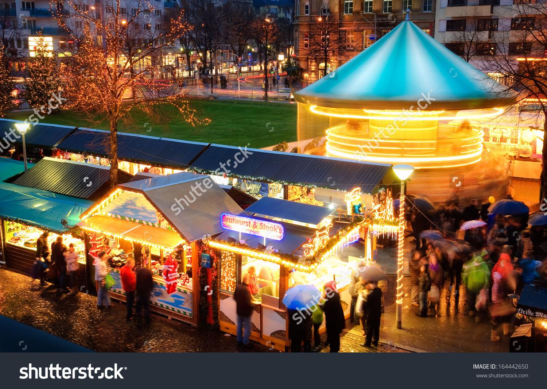 Illuminated Christmas Fair Loads Movement People Stock Photo.