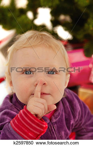 Stock Photography of Cute baby saying shhh.