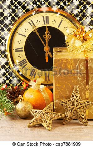 Stock Photographs of Christmas still life. Clock, gift box, pine.
