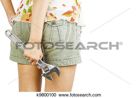 Stock Photography of woman holding big chrome vanadium spanner in.