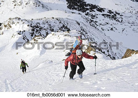 Stock Photography of Climbers ascend peak in Chugach Mountains for.