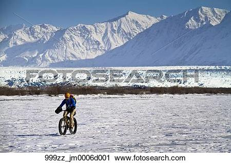 Stock Photography of Man Fat Tire mountain biking on the Knik.