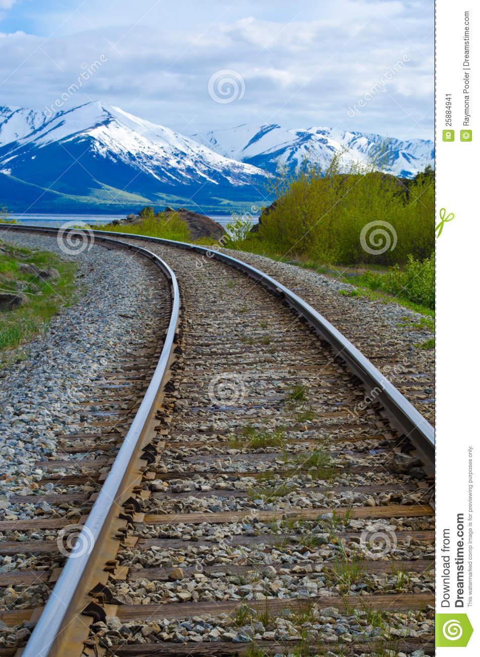 Railroad Tracks Leading Into The Chugach Mountains Stock Image.