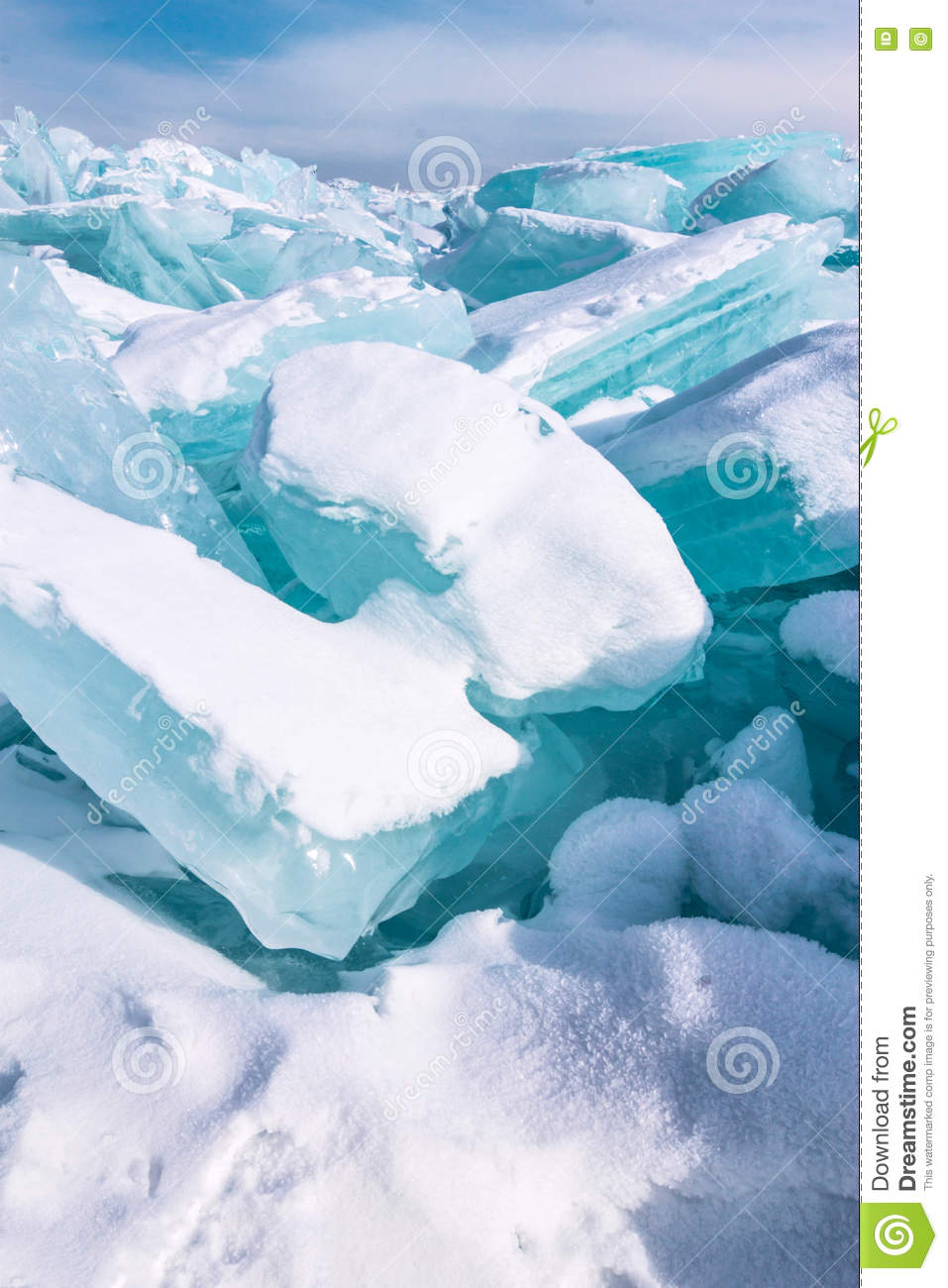 Ice Chunks Of Blue Ice Is Covered With Snow Stock Photo.