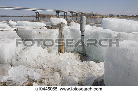 Stock Image of Large chunks of ice on banks of Red River, Manitoba.
