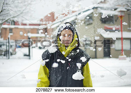 Picture of Falling chunks of snow in front of a person; victoria.