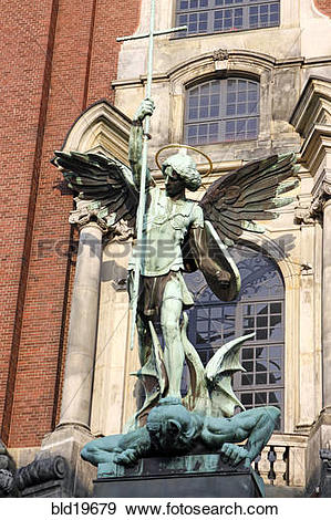 Stock Photograph of Sculpture archangel Michael defeats the Satan.