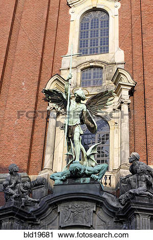 Stock Photography of Sculpture archangel Michael defeats the Satan.