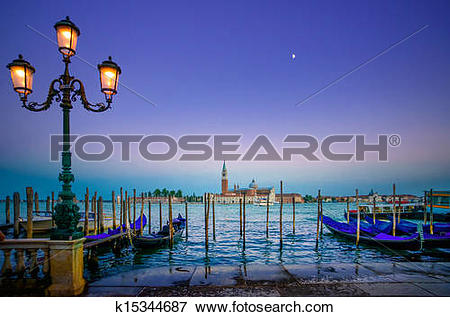 Picture of Venice, street lamp and gondolas or gondole on sunset.