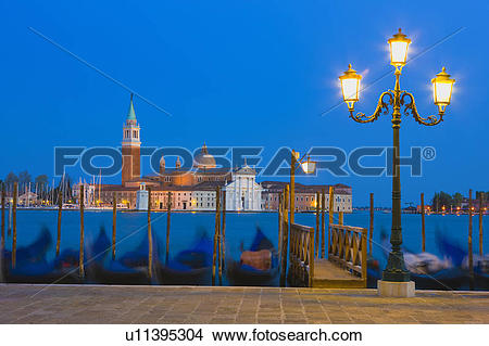 Stock Photo of Gondolas with the church of Saint George Major in.