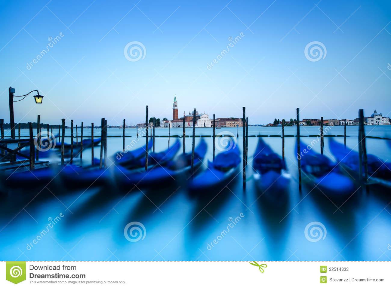 Venice, Gondolas Or Gondole On Sunset And Church On Background.