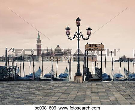 Stock Images of Gondolas docked in urban pier pe0081606.