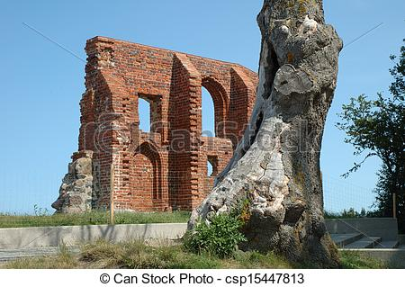 Stock Photography of Tree and church ruins in Trzesacz in Poland.