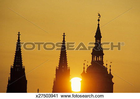 Stock Photography of Gothic church spires in front of red.
