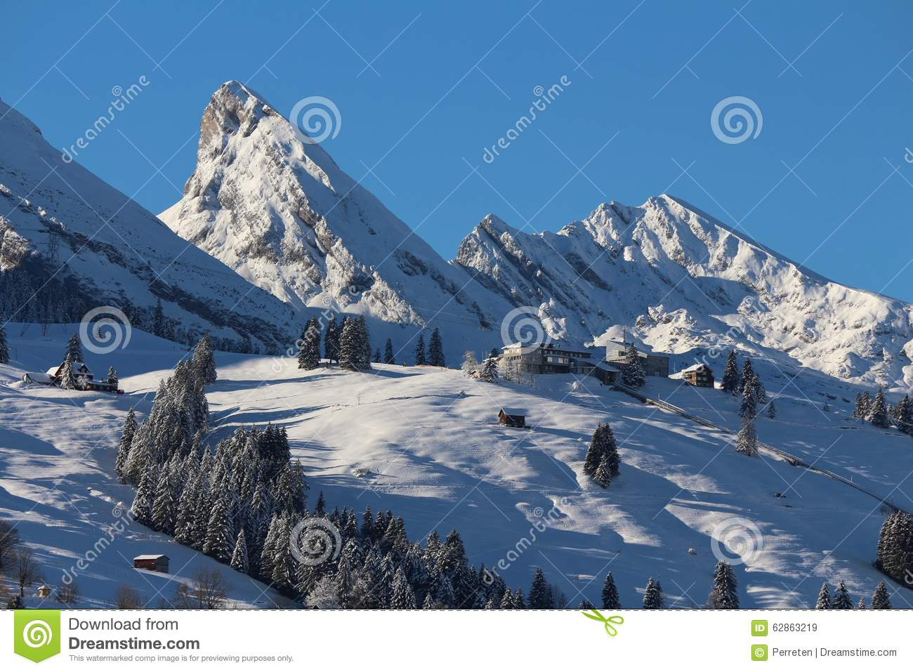 Mountain Peaks Of The Churfirsten In Winter And Ski Area Stock.