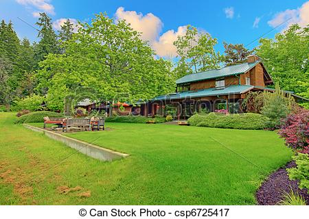 Picture of Large cider house with covered deck and garden.