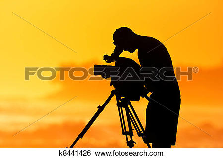 Stock Images of Camera Man, Professional Cinematographer at Sunset.