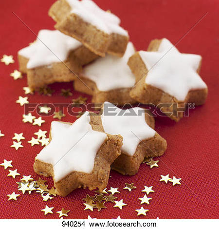 Stock Photo of Cinnamon stars and small, golden stars 940254.