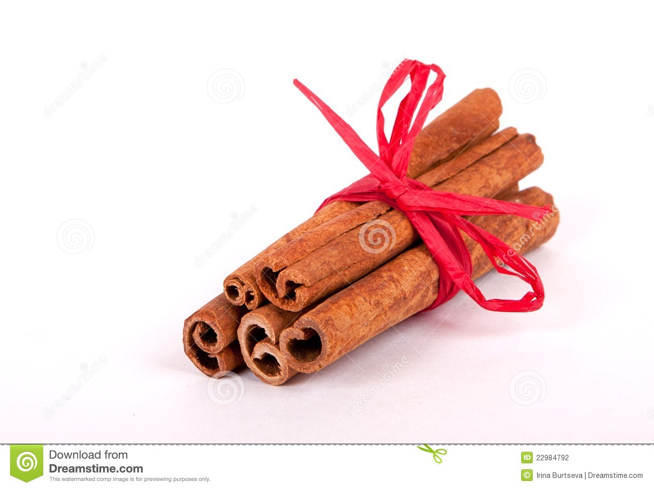Cinnamon Sticks With Red Ribbon Stock Photography.
