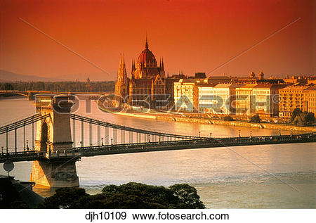 Stock Photograph of City Skyline at sunser with Chain Bridge and.