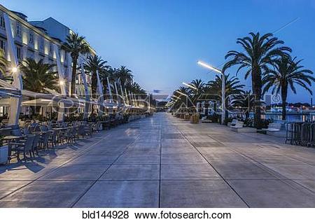 Pictures of Promenade, buildings and city sidewalk at dusk, Split.