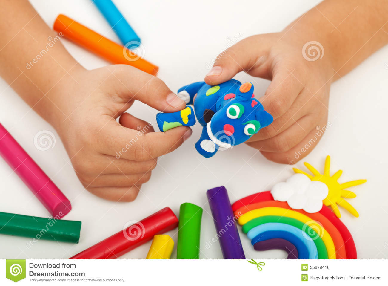 Child Playing With Colorful Clay Making Animal Figures Closeup On.