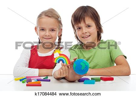 Stock Photo of Kids making ecology theme clay figures k17084484.