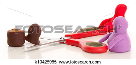 Stock Image of Modelling clay figures with scissors k10425985.
