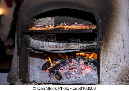 Stock Photos of Traditional Hungarian Langallo cooking in a clay.