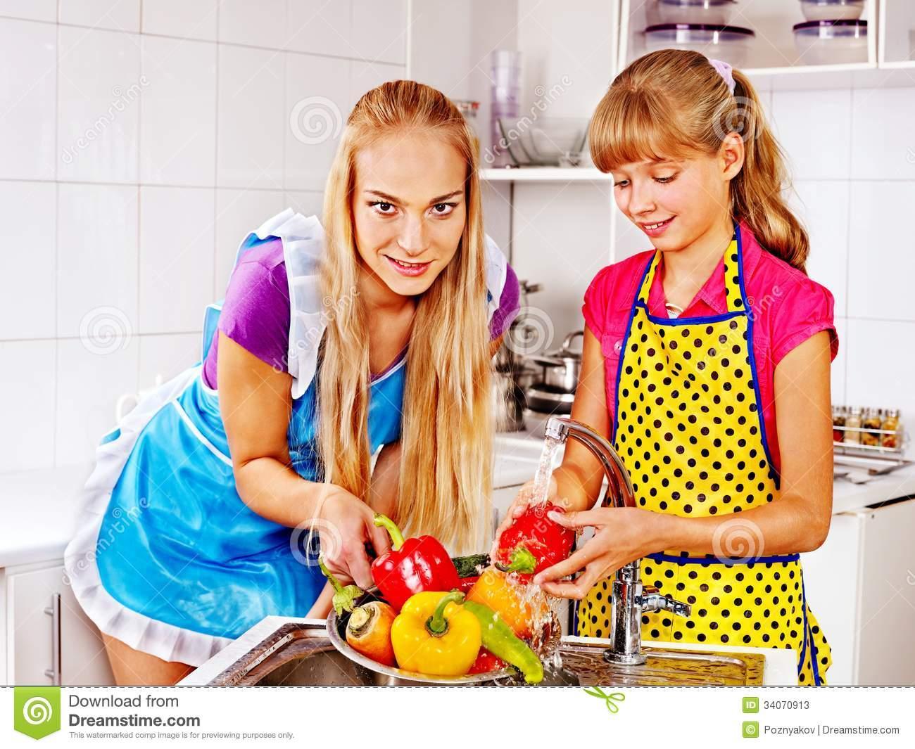 Children Washing Fruit At Kitchen. Royalty Free Stock Image.