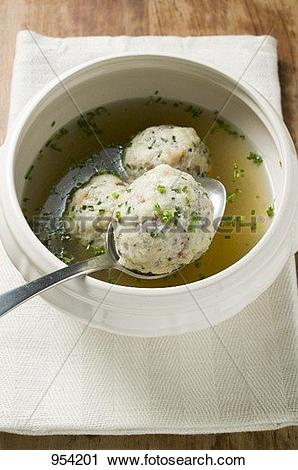 Stock Photography of Clear broth with bacon dumplings in soup bowl.
