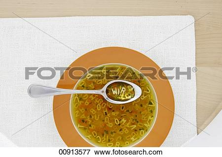 Picture of Clear broth with vegetables and alphabet noodles.
