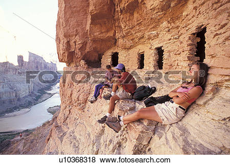 Pictures of Rock Climbers Resting in Front of Cliff Dwellings.