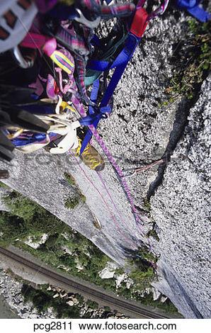 Stock Photography of Rock climber solo aid climbing BC Canada.
